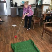 Elderly woman playing golf
