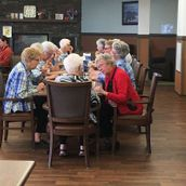 Seniors enjoying a meal